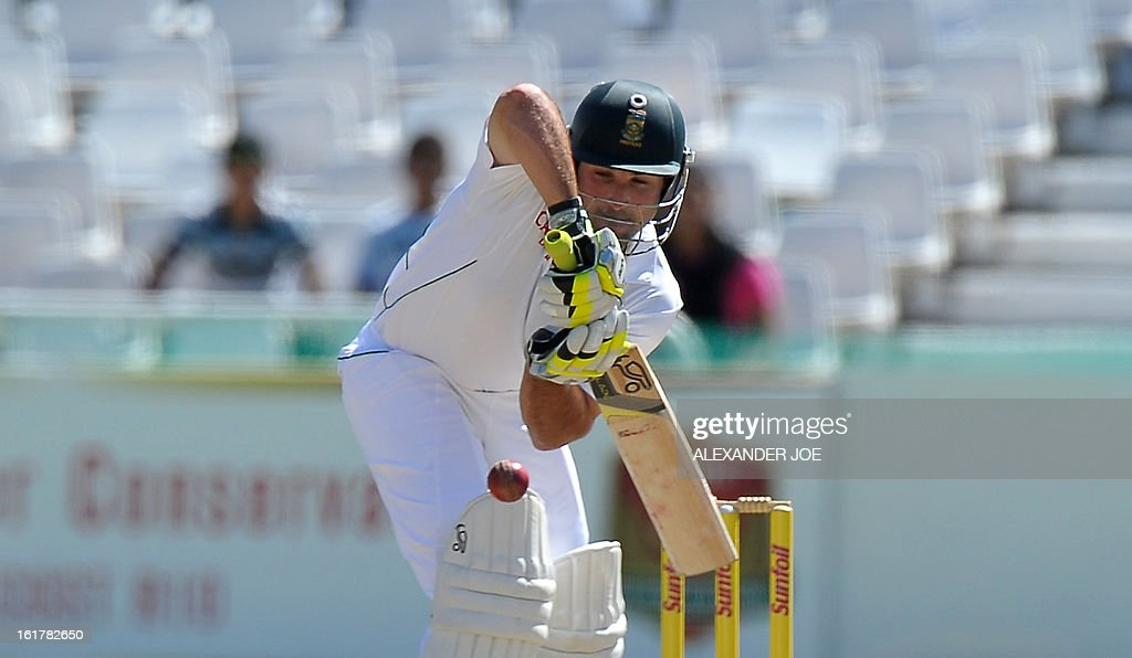 South African cricketer Dean Elgar plays a shot from unseen Pakistan cricketer Umar Gul on Day 3 of the Second Test between South Africa and Pakistan at Newlands in Cape Town on February 16, 2013.