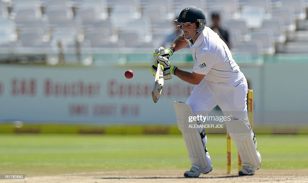 South African cricketer Dean Elgar plays a shot from unseen Pakistan cricketer Umar Gul on Day 3 of the second Test between South Africa and Pakistan at Newlands in Cape Town, on February 16, 2013.