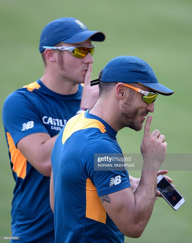South African cricketer Faf du Plessis (R), along with teammate <a gi-track='captionPersonalityLinkClicked' href=/galleries/search?phrase=David+Miller+-+Cricket+Player&family=editorial&specificpeople=15061693 ng-click='$event.stopPropagation()'>David Miller</a>, urges spectators to remain silent during training on the eve of the second one day international (ODI) cricket match between India and South Africa at The Holkar Cricket Stadium at Indore on October 14, 2015.