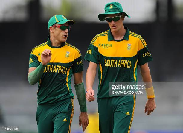 South African cricketer Faf du Plessis talks to Chris Morris during the second One Day International match between Sri Lanka and South Africa at the...