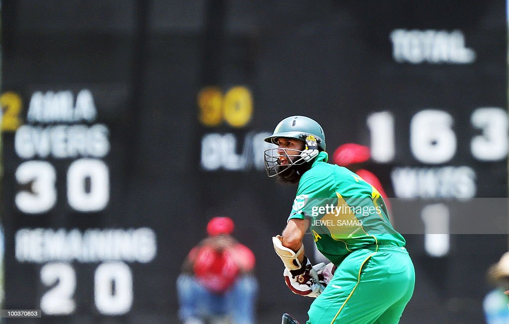 South African cricketer Hashim Amla eyes the ball before playing a shot during the second One Day International match between West Indies and South Africa at the Sir Vivian Richards Stadium in St John's on May 24, 2010. Amla scored 92-runs before being dismissed. AFP PHOTO/Jewel Samad