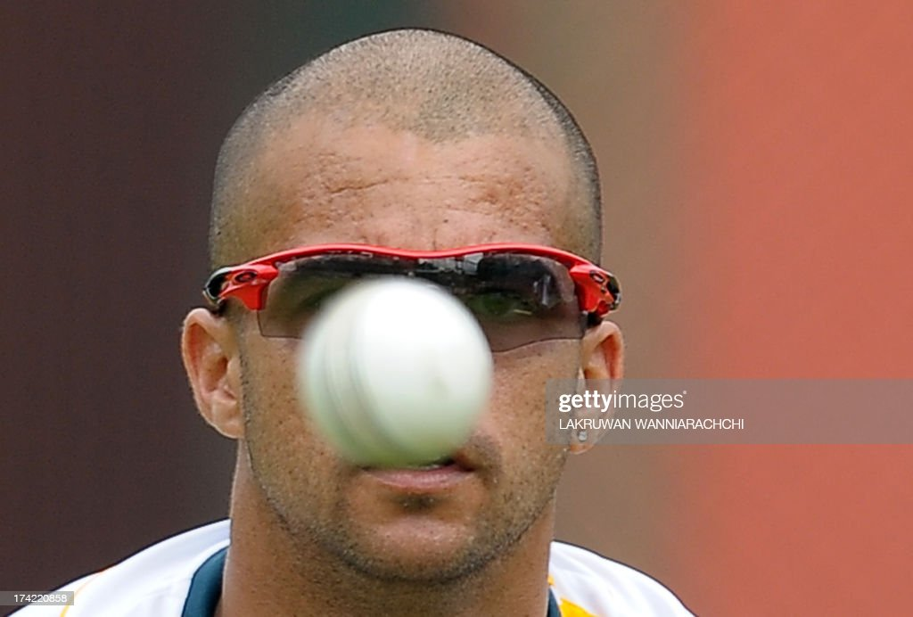 South African cricketer Jean-Paul Duminy throws a ball during a practice session at the R. Premadasa Stadium in Colombo on July 22, 2013.The second ODI between South Africa and Sri Lanka will be played on July 23, 2013.
