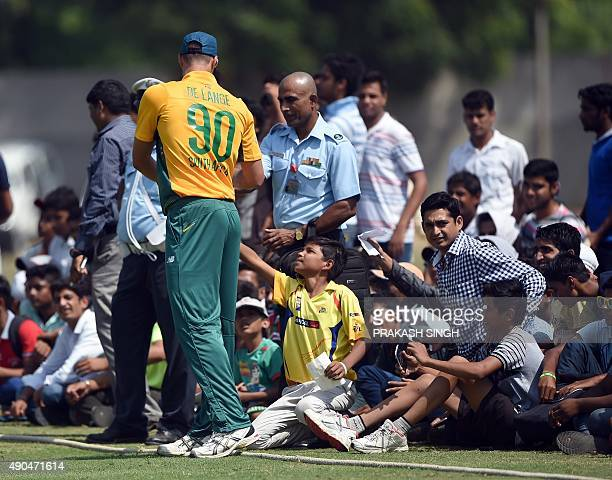 South African cricketer Marchant de Lange gives autographs to spectators during the T20 practice match between India A and the visiting South...