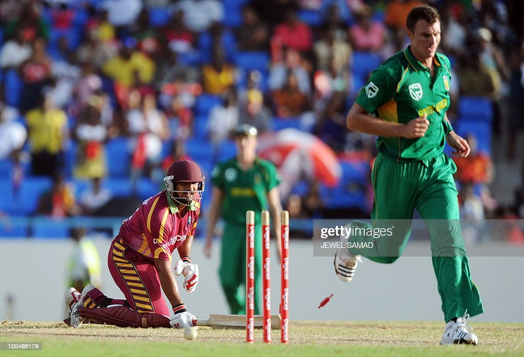 South African cricketer Ryan McLaren (R) runs out West Indies batsman Ravi Rampaul during the second One Day International match between West Indies and South Africa at the Sir Vivian Richards Stadium in St John's on May 24, 2010. Batting first, South Africa scored 300-runs at the end of their innings. AFP PHOTO/Jewel Samad