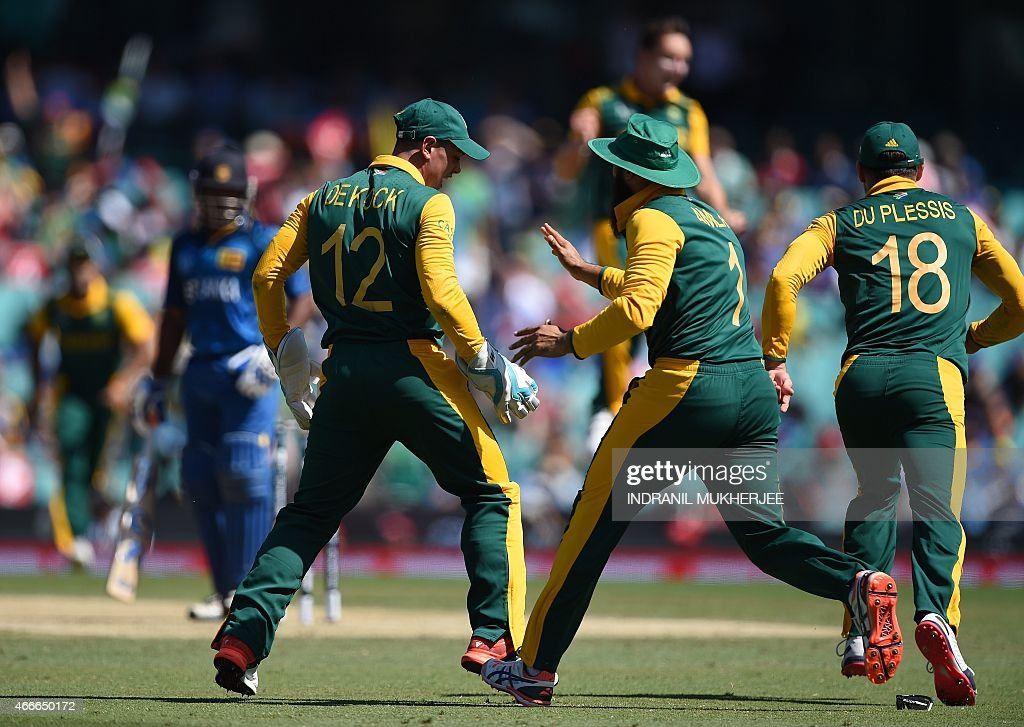 South African cricketers <a gi-track='captionPersonalityLinkClicked' href=/galleries/search?phrase=Hashim+Amla&family=editorial&specificpeople=647392 ng-click='$event.stopPropagation()'>Hashim Amla</a> (C) and Faf du Plessis (R) reacts as wicketkeeper Quinton de Kock (front L) takes a catch to dismiss Sri Lankan cricketer Kusal Perera (back L-in blue) at the Sydney Cricket Ground during the 2015 Cricket World Cup quarter-final match between Sri Lanka and South Africa in Sydney on March 18, 2015.