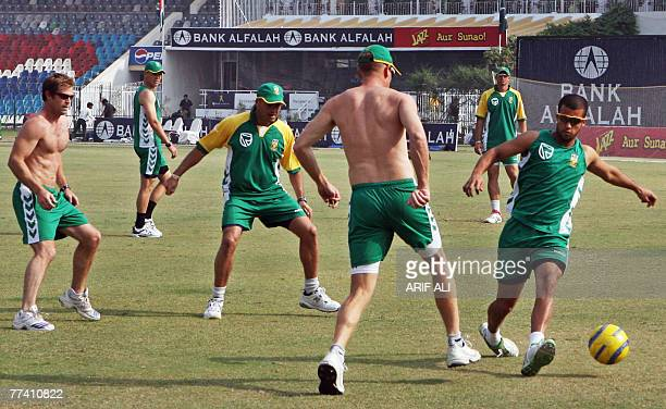 South African cricketers play football during a team practice session at the Gaddafi Stadium in Lahore 19 October 2007 South African cricket...