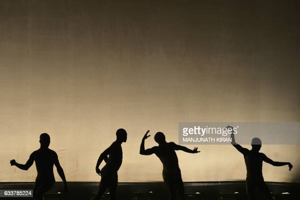 South African dancers from the Vuyani Dance Theatre perform on the second day of the Attakalari Biennial 2017 a 10day contemporary movement arts...