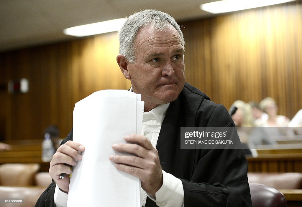 South African defence attorney Barry Roux attends on March 28, 2013 the bail application appeal of his client, South African Olympic sprinter Oscar Pistorius, at the North Gauteng Hight Court in Pretoria. The court cleared Pistorius for international travel after the Paralympian sprint star, charged with murdering his girlfriend, challenged his stringent bail terms. Pistorius, 26, had appealed against a raft of conditions including the confiscation of his passport that he said were unfair and unwarranted. The double amputee -- who faces trial later this year over the Valentine's Day killing of his model girlfriend Reena Steenkamp -- was not in court for the appeal, which was opposed by the state.