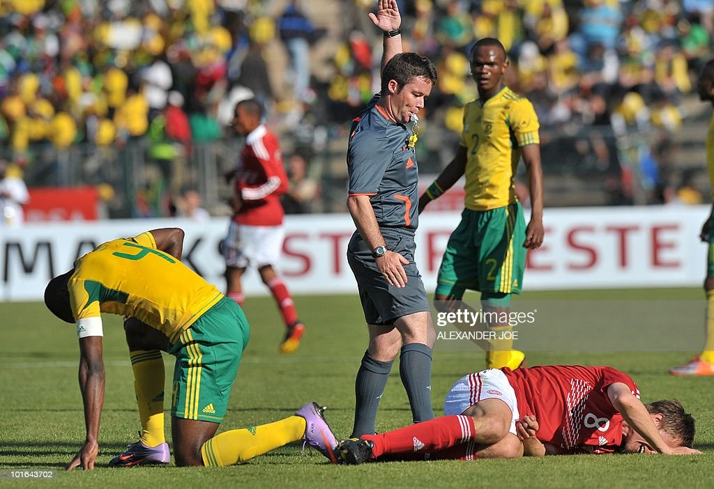 South African defender Aaron Mokoena (L) reacts after a tackle with Denmark's Desper Granhder during the WC2010 friendly football match between South Africa vs. Denmark at Super Stadium, in Pretroria on June 5, 2010 ahead of the FIFA World Cup 2010 held in South Africa. South Africa won the match 1-0.