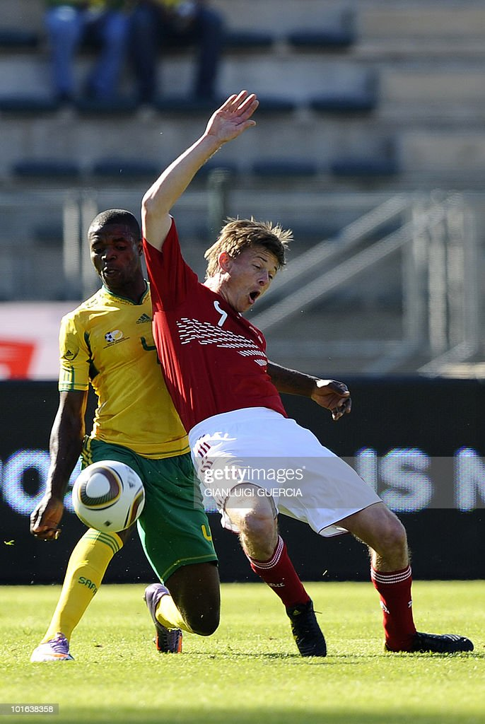 South African defender and captain Aaron Mokoena (L) tackles Denmark's Jon Dahl Tomaasson on June 5, 2010 during a friendly football match at Superstadium in Atridgville, Pretoria.