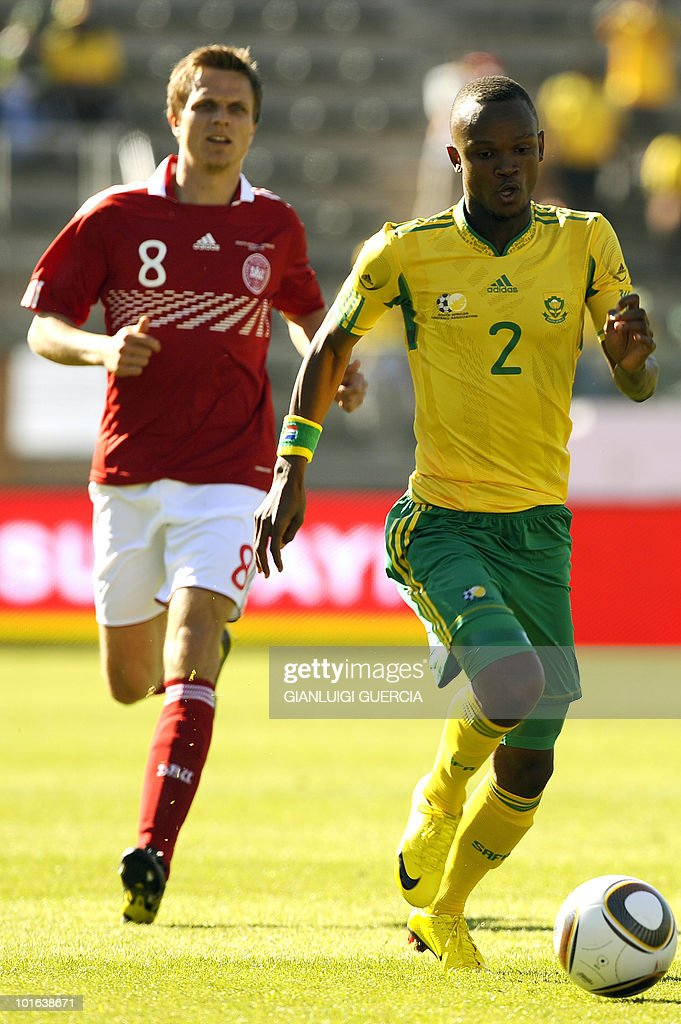 South African defender Gaxa Siboniso (R) tries to break loose on June 5, 2010 during a friendly match between South Africa and Denmark at Superstadium in Atridgville, Pretoria.