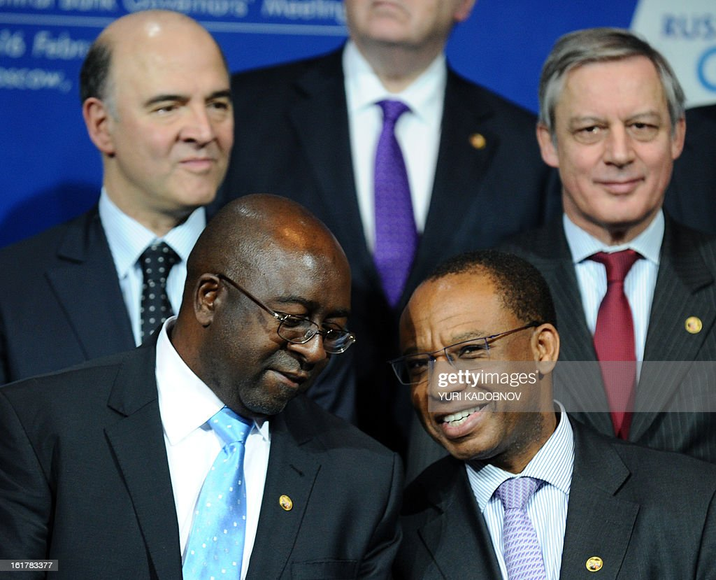 South African Deputy Minister of Finance, Nhlanhla Musa Nene (bottom L) speaks with South African Reserve Bank Deputy Governor, Daniel Mminele (bottom R), as they together with French Economy, Finance and Foreign Trade Minister, Pierre Moscovici (top L) and Bank of France Governor Christian Noyer (top R) prepare to pose for family picture after G20 states finance ministers and central bank governors meeting in Moscow, on February 16, 2013. The ministers and central bank governors gathered today in Moscow for their first meeting in the Russian capital aimed at reassuring markets that the world's economic powers would not slug it out in 'currency wars' to boost national growth. AFP HOTO / YURI KADOBNOV