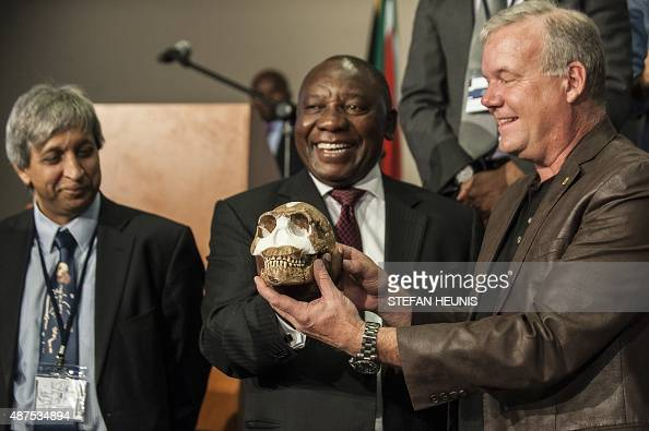 South African Deputy President Cyril Ramaphos and professor Lee Berger hold a replica of the skull of a Homo Naledi a newly discovered human ancestor...