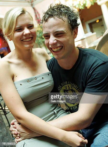 South African double amputee sprinting champion Oscar Pistorius with his girlfriend Victoria Miles on June 1 2006 in Pretoria South Africa