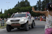 South African driver Giniel De Villiers is received by fans at the end of the 6th stage of Rally Dakar 2014 ArgentinaBolivaChile on January 10 2013...
