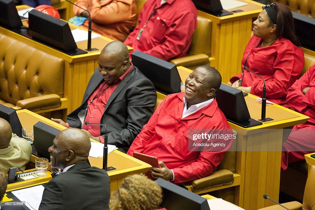 South African Economic Freedom Fighters (EFF) leader, <a gi-track='captionPersonalityLinkClicked' href=/galleries/search?phrase=Julius+Malema&family=editorial&specificpeople=5866727 ng-click='$event.stopPropagation()'>Julius Malema</a> laughs during a debate on the State of the Nation Address (SONA) at the parliament in Cape Town, South Africa on February 17, 2015.