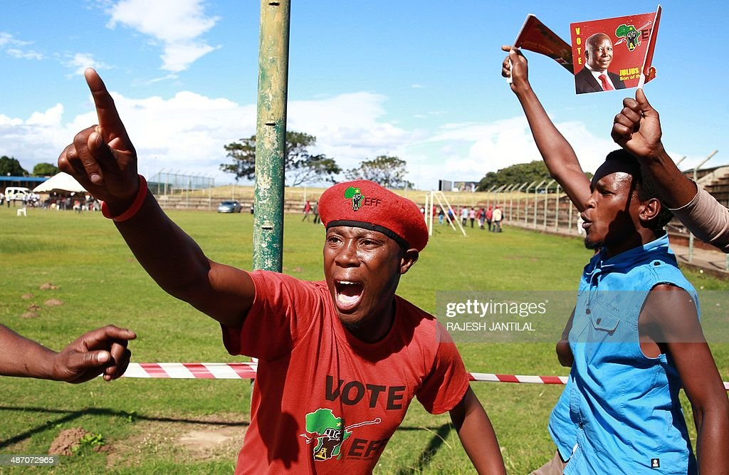South African Economic Freedom Fighters (EFF) party supporters cheer during an election campaign rally in Umlazi, south of Durban, South Africa, on April 27, 2014. South Africans are going to the polls for a general election on May 7, 2014.
