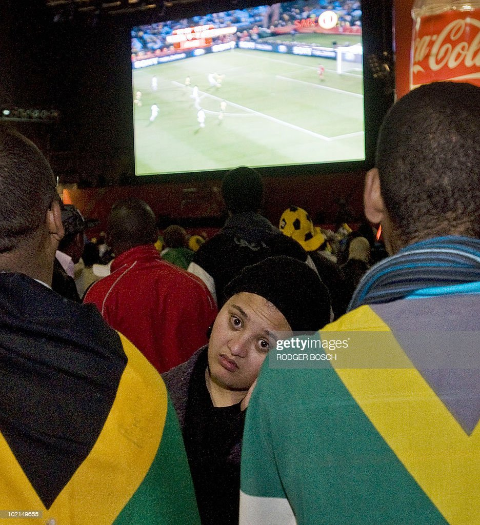 A South African fan in Cape Town looks away as Uruguay wins 3-0 in their 2010 World Cup match against South Africa on June 16, 2010.