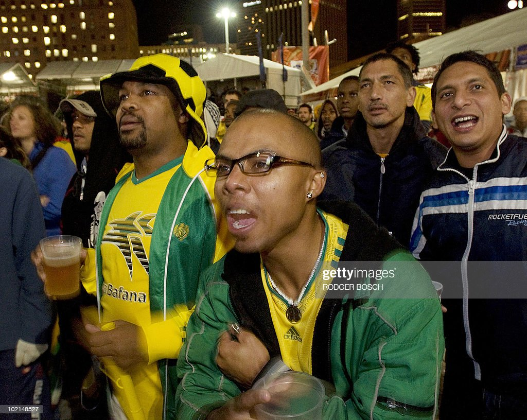 South African fans at the FIFA Fanfest on June 16, 2010, in Cape Town, watch the Group A first round 2010 World Cup football match South Africa vs. Uruguay.