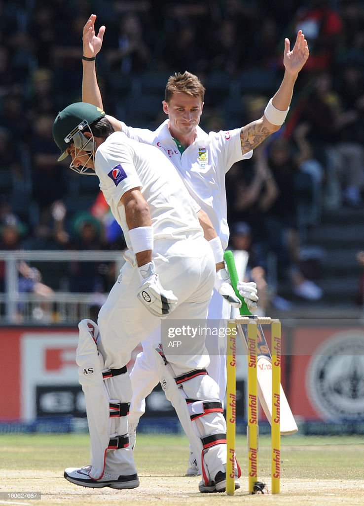 South African fast bowler Dale Steyn (background) celebrates the wicket of Shafiq Asad (L) on day four of the first test match between South Africa and Pakistan on February 4, 2013 at Wanderers Stadium in Johannesburg.