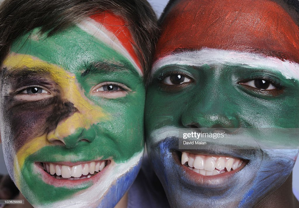 South African flag painted on two boys faces. : Stock Photo