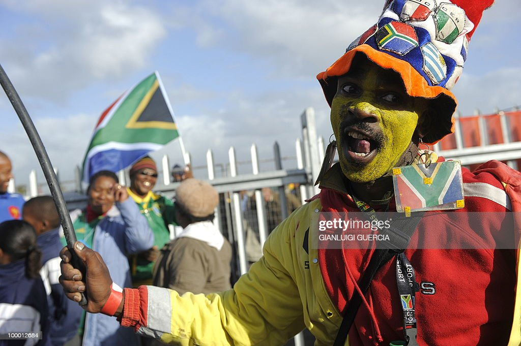 South African football fans cheer up as they wait to enter the O.R Tambo center and see the FIFA World Cup trophy after the unveiling on May 07, 2010 during the kick off of its South African tour in Kayelitsha on the outskirt of Cape Town, South Africa.