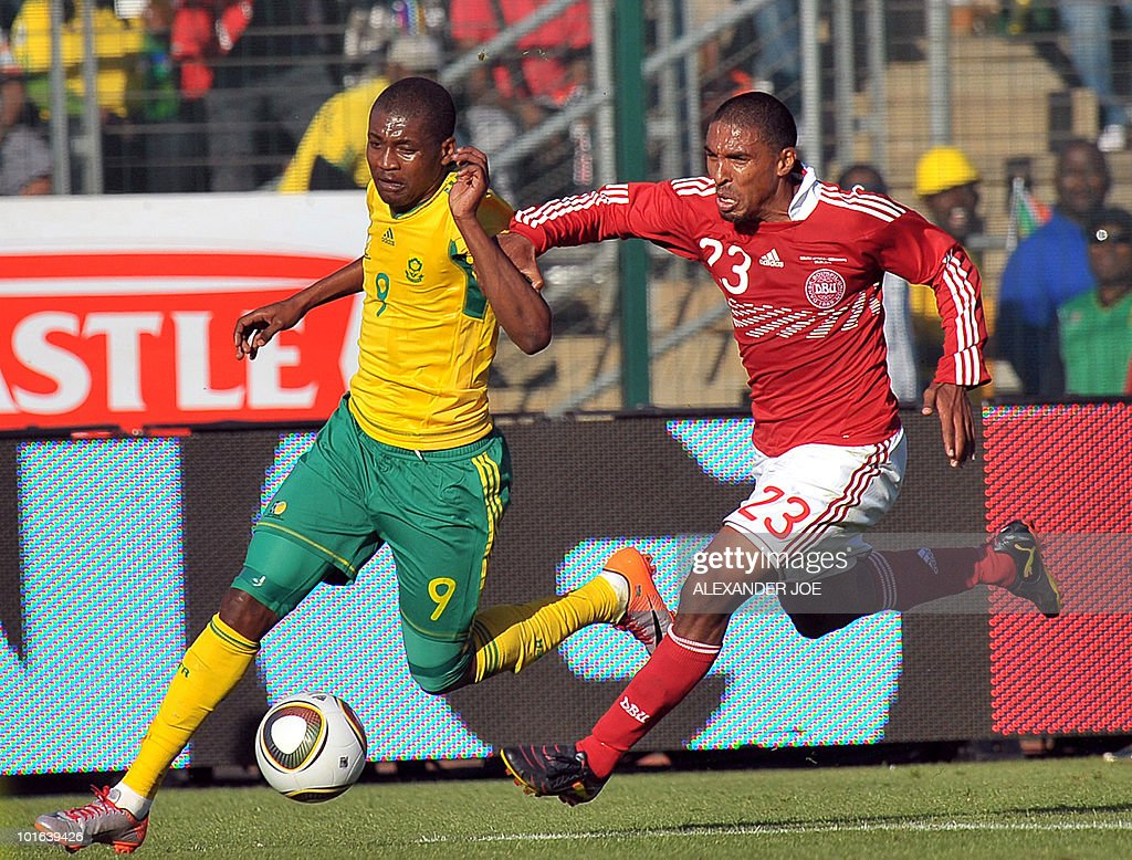 South African football Striker Katlego Mphela (L) fights for the ball with Denmark's player Mtigliga Patrick during a friendly football match between South Africa and Denmark at Super Stadium, Atteridgeville in Pretoria on June 05, 2010, prior to the FIFA 2010 World Cup in South Africa.