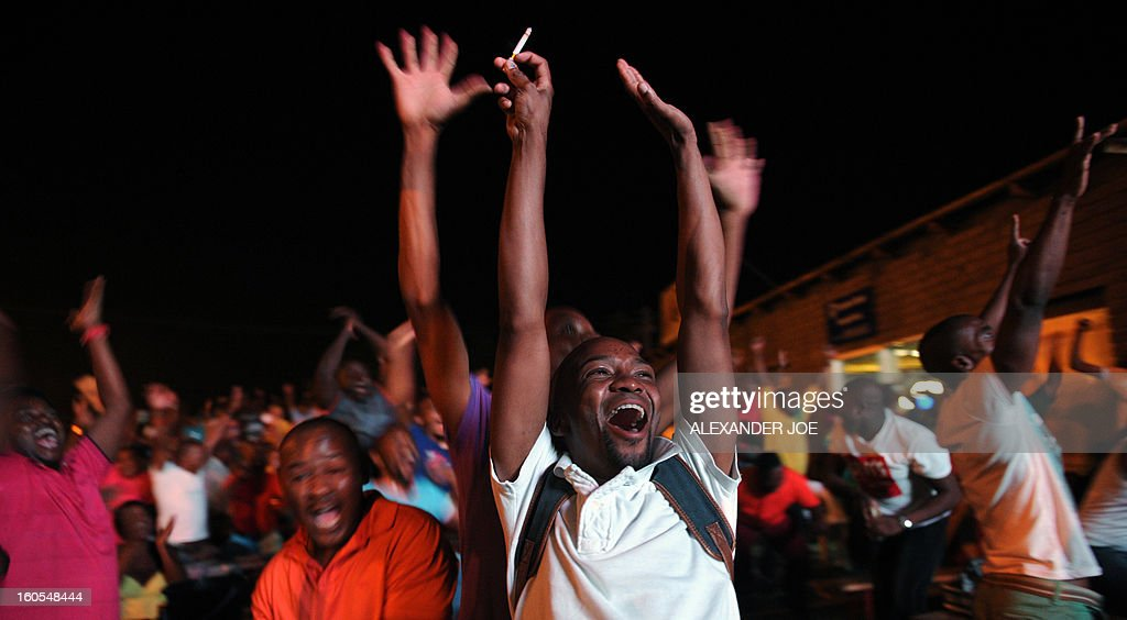 South African football team's supporters celebrate a goal scored on February 2, 2013 in Rustenburg, during the African Cup of Nation 2013 quarter final football match South-Africa vs Mali in Durban.