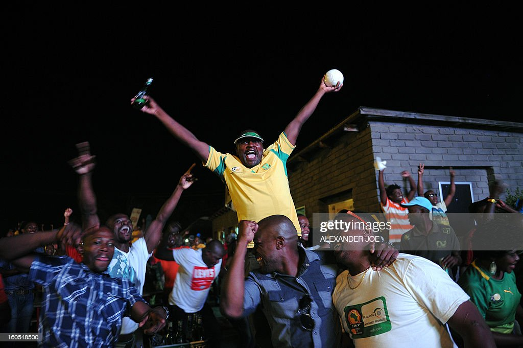 South African football team's supporters celebrate a goal scored on February 2, 2013 in Rustenburg, during the African Cup of Nation 2013 quarter final football match South-Africa vs Mali in Durban. AFP PHOTO ALEXANDER JOE