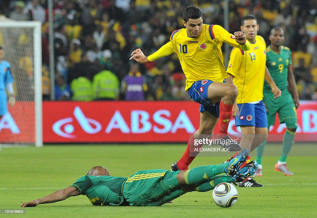 South African footballer Kagisho Gikgacoi (down) vies with Colombia's Giovanni Moveno during a friendly football match between South Africa vs Colombia at Soccer City Stadium in Soweto on May 27 , 2010 ahaed of the FIFA 2010 World Cup in South Africa.