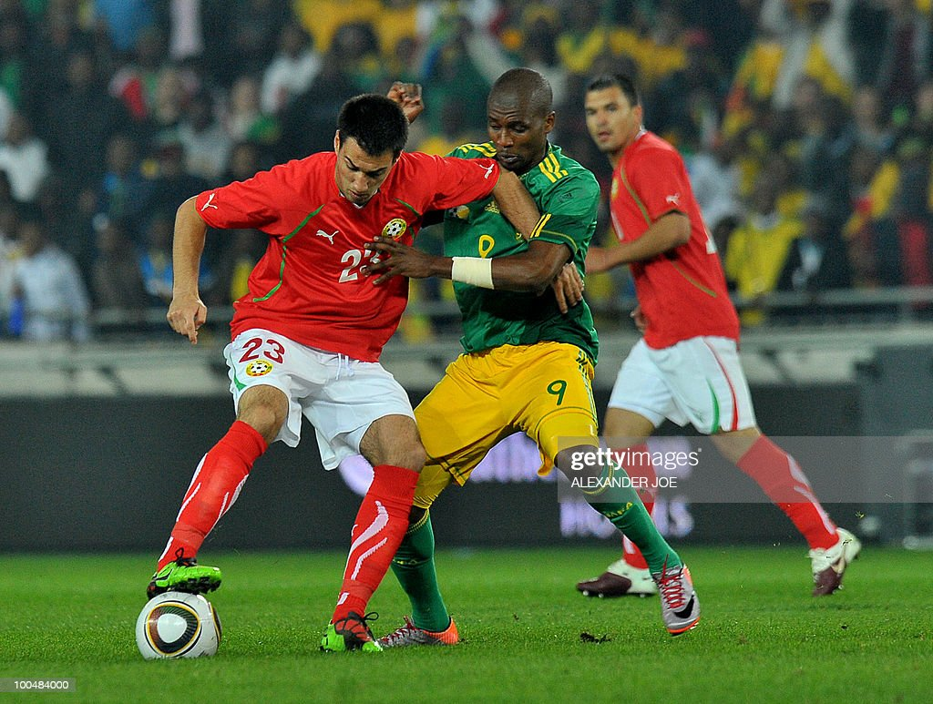 South African footballer Katlego Mphela (R) holds back Ivelin Popov of Bulgaria during the friendly football match between South Africa vs Bulgaria at Orlando Stadium in Soweto on May 24, 2010 ahaed of the FIFA 2010 World Cup in South Africa.