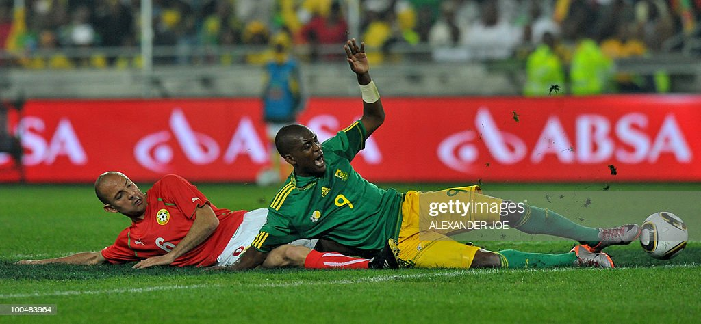 South African footballer Katlego Mphela (9) (R) is tackled by 6 Stanislav Angelov Midfielder of Bulgaria during the friendly football match between South Africa vs Bulgaria at Orlando Stadium in Soweto on May 24, 2010 ahaed of the FIFA 2010 World Cup in South Africa.