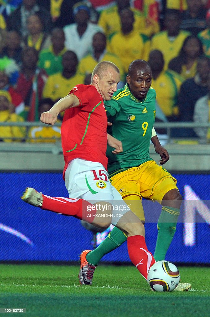 South African footballer Katlego Mphela (9) tackles Ivan Ivanov of Bulgaria (15) during their friendly football match between South Africa vs Bulgaria at Orlando Stadium in Soweto on May 24, 2010 ahaed of the FIFA 2010 World Cup in South Africa.