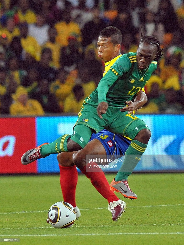 South African footballer Reneilwe Letsholonyane avoids a tackel fom Colombia's Fredy Guarin during a friendly football match between South Africa and Colombia at Soccer City Stadium in Soweto on May 27, 2010 ahead of the FIFA 2010 World Cup in South Africa.