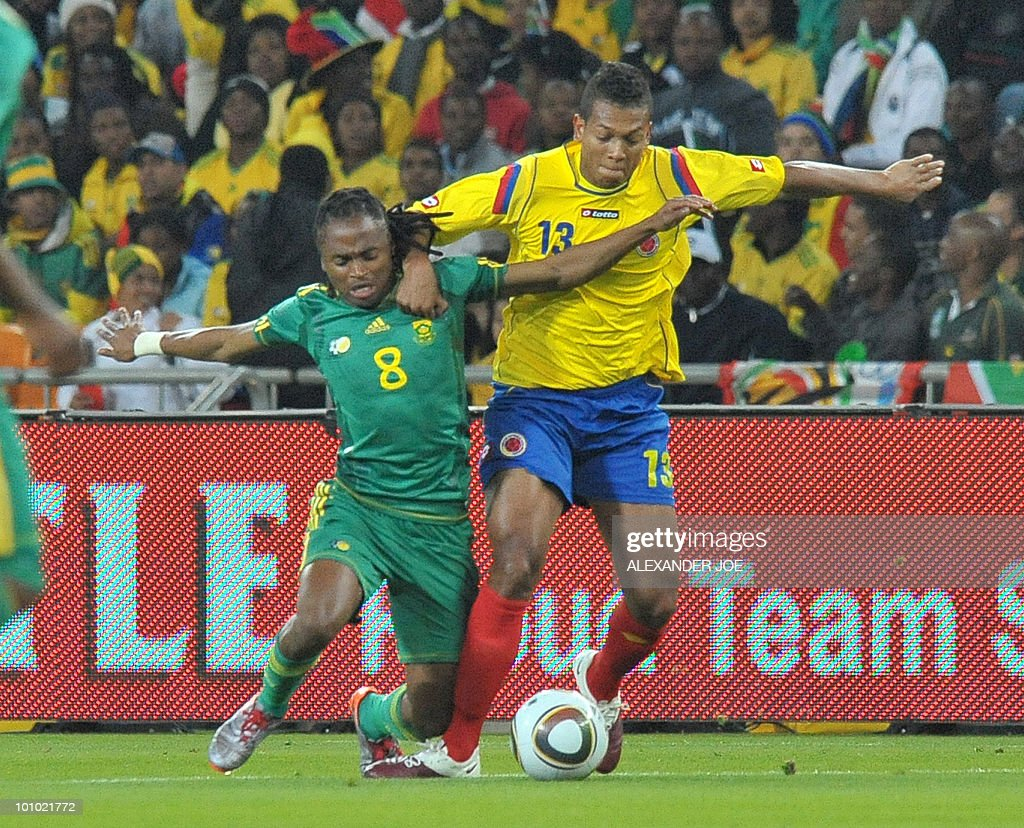 South African footballer Siphiwe Tshabalala vies for the ball against Colombia's Fredy Guarin during a friendly football match between South Africa vs Colombia at Soccer City Stadium in Soweto on May 27 , 2010 ahaed of the FIFA 2010 World Cup in South Africa.