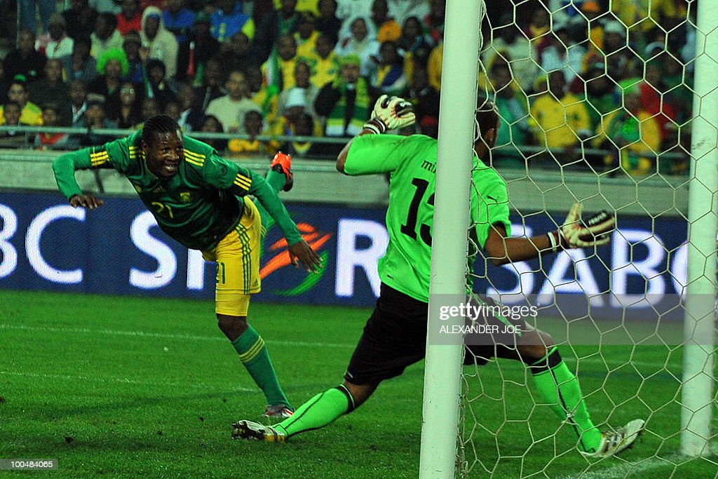 South African footballer Siyabonga Sangweni (L) scores the first goal aginist Bulgaria during the friendly football match between South Africa vs Bulgaria at Orlando Stadium in Soweto on May 24, 2010 ahaed of the FIFA 2010 World Cup in South Africa