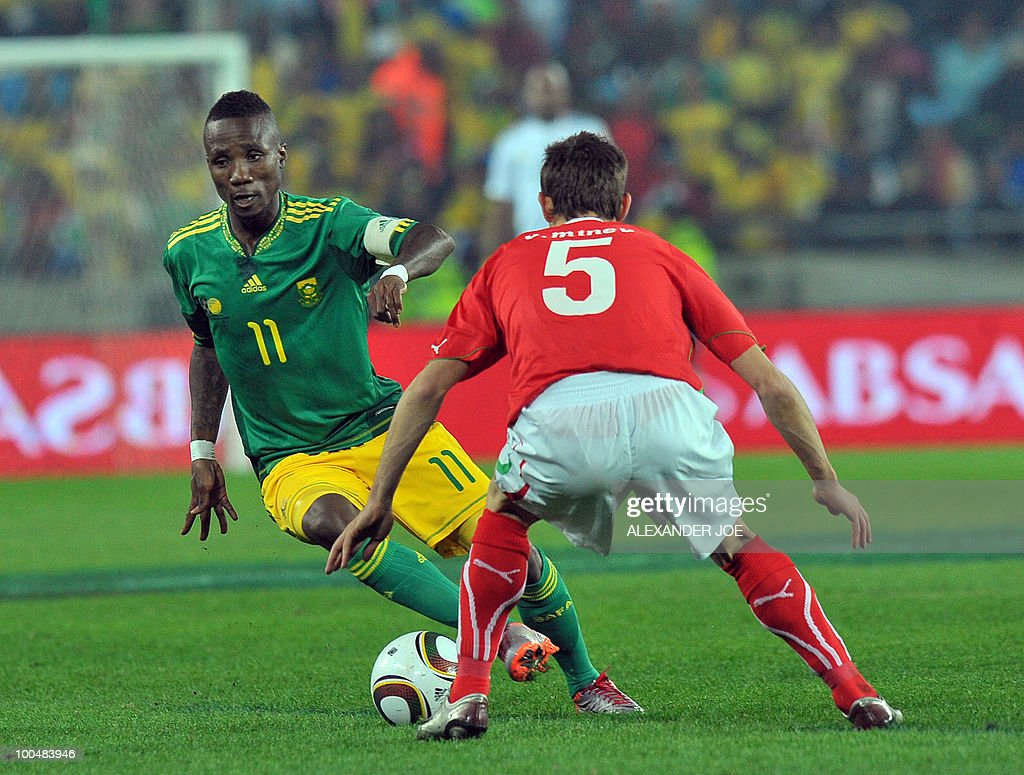 South African footballer Teko Modise (captain, L) vies with Ivan Stoyanov Midfielder of Bulgaria's team during the friendly football match between South Africa vs Bulgaria at Orlando Stadium in Soweto on May 24, 2010 ahaed of the FIFA 2010 World Cup in South Africa.