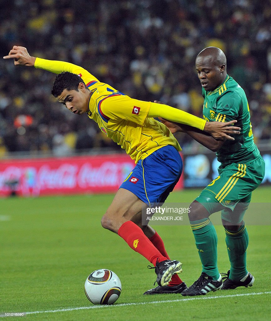 South African footballer Thanduyise Khuboni (R) tackles Colombia's Giovanni Moveno during a friendly football match between South Africa vs Colombia at Soccer City Stadium in Soweto on May 27 , 2010 ahaed of the FIFA 2010 World Cup in South Africa.