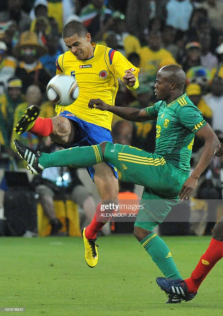 South African footballer Thanduyise Khuboni vies with Colombia's Doran Pabon during a friendly football match between South Africa vs Colombia at Soccer City Stadium in Soweto on May 27 , 2010 ahaed of the FIFA 2010 World Cup in South Africa.