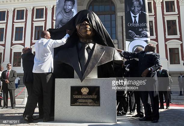 South African former president Nelson Mandela's grandson Mandla Mandela and South African president Jacob Zuma unveil a bust of Nelson Mandela...
