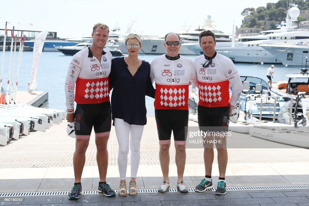 South African former rugby player Percy Montgomery, Princess Charlene of Monaco, Prince Albert II of Monaco, and Charlene's brother Gareth Wittstock of South Africa, pose as they attend the arrival of the first 'Riviera Water Bike Challenge', a water bike race between Nice and Monaco, in Monaco, on June 4, 2017. /