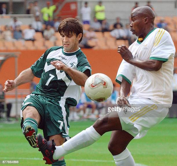 South African forward Siyabonga Nomvethe and Slovenian midfielder Doni Novak clash in their Group B match at the 2002 FIFA World Cup Korea/Japan in...