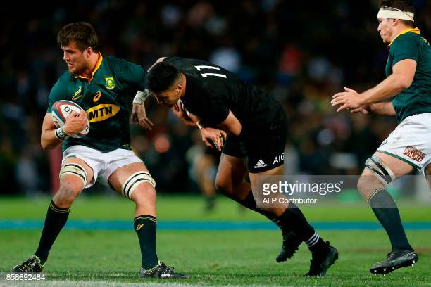 South African Franco Mostert is tackled by New Zealand Rieko Ioane during the Rugby test match between South Africa and New Zealand at Newlands Rugby...