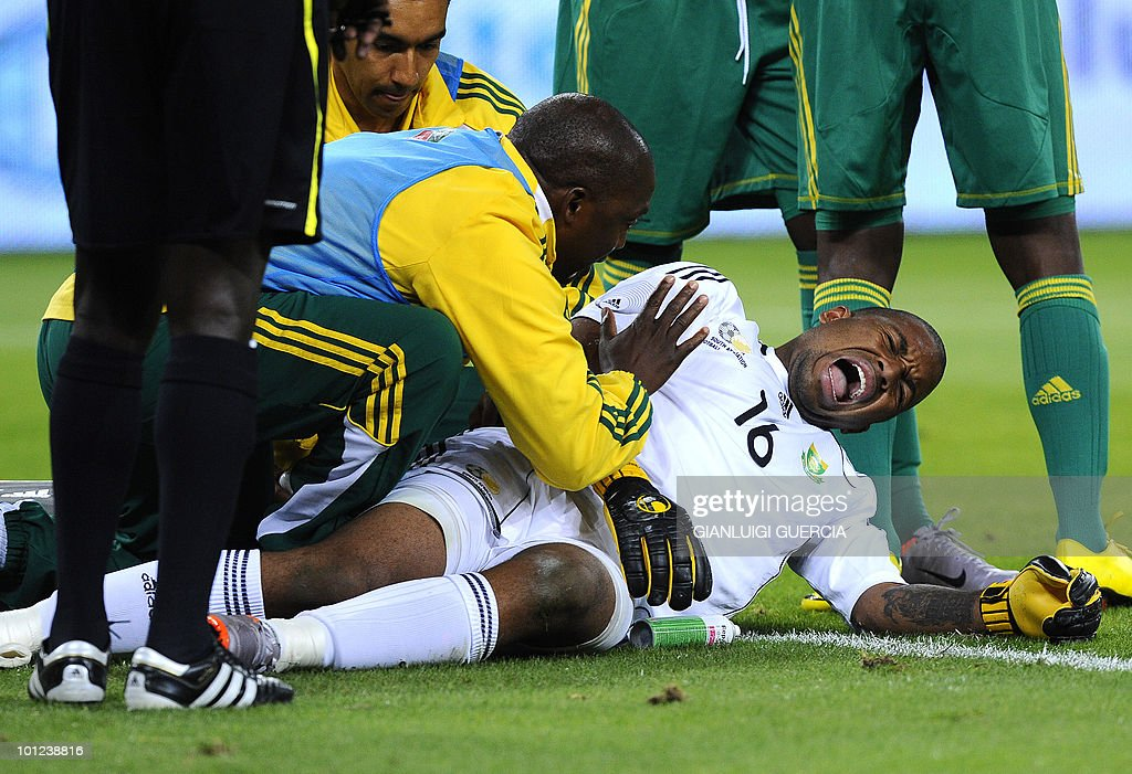 South African goalkeeper Itumelng Khune reacts in pain after clashing with a Colombian player during their international friendly football match at the Soccer City stadium in Soweto, Johannesburg on May 27, 2010. The 2010 FIFA World Cup football championship is due to take place in South Africa from June 11 to July 11 of 2010.