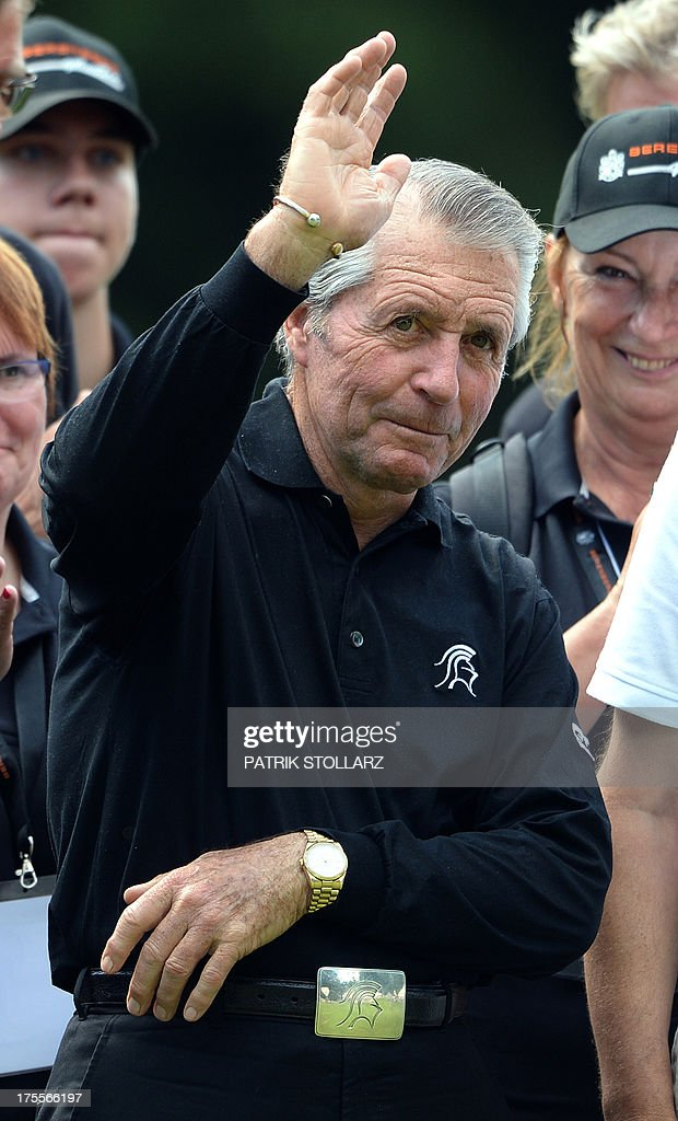 South African golf legend Gary Player waves after the Berenberg Bank Masters Cologne European Senior Tour at the Golf and Country Club Cologne in Bergisch Gladbach near Cologne, western Germany on August 4, 2013.
