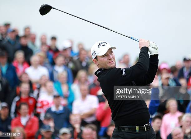 South African golfer Branden Grace drives from the first tee during the 2012 Irish Open held on the Dunluce Links at the Royal Portrush Golf Club on...