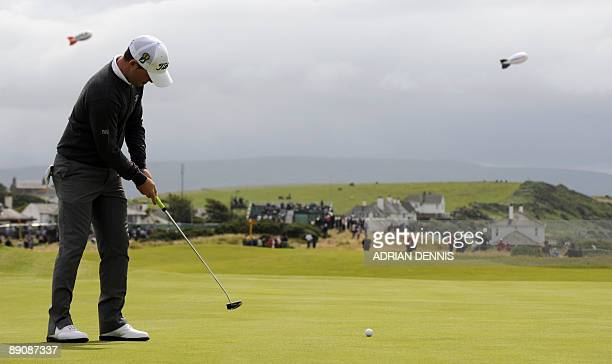 South African golfer Branden Grace putts on the 6th green on the third day of the 138th British Open Championship at Turnberry Golf Course in south...