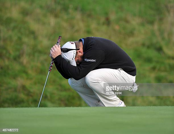South African golfer George Coetzee reacts after missing a putt on the 18th green during the semi final of the Volvo World Match Play Championship at...