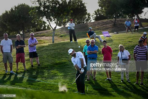 South African golfer Hennie Otto putts to the 15th hole during third round of the Portugal Masters golf tournament at Victoria Golf Course in...