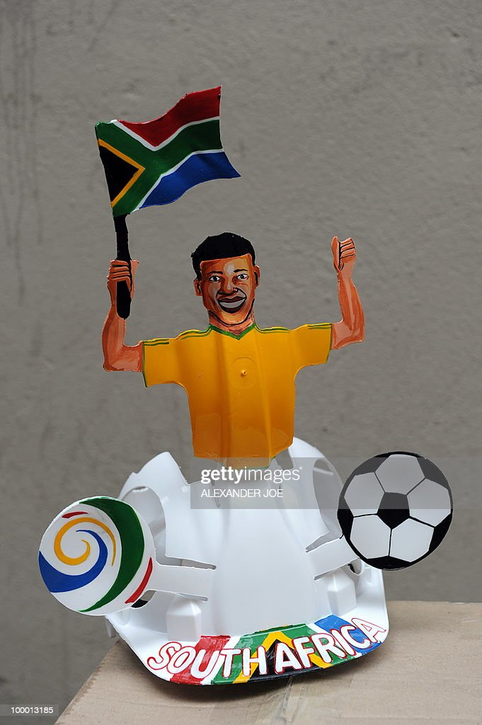 A South African hard hat known as 'Makarapas' is pictured in Johannesburg on March 24, 2010. The 'Makarapas', a decorated plastic hard hat to be settled on supporters' heads, are created by fans who carve shapes into the hats and adorn them with team colours, a process that can take four days to complete. As the world prepares for Africa's first World Cup, interest is growing in the continent, especially since the governing body FIFA ordered 2,000 Makarapas for twelve of the top teams from Wygers' factory in downtown Johannesburg. The Makarapa is, with the vuvuzela trumpet, an important part of the local football matches' festival atmosphere. Makarapas are hand-cut and hand painted miner hard hats in the colours of a team.